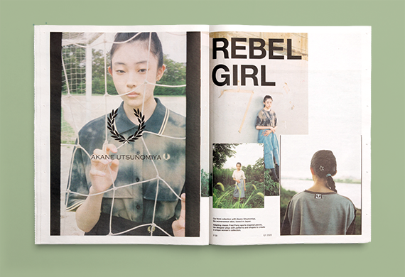 Open tabloid newspaper with a young woman and the title 'rebel girl' on a green background